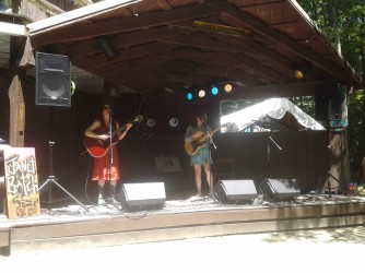 Female folk at the cafe stage in the woods.